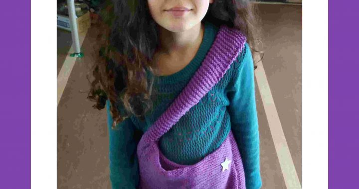 Pippi with purple knitted bag trade